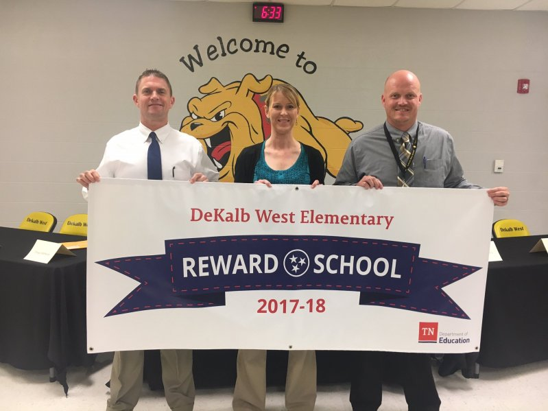 Director of Schools Patrick Cripps joined Principal Sabrina Farler and Assistant Principal Joey Agee Thursday night in displaying a new banner proudly proclaiming DeKalb West School as a Reward School for 2017-18. The designation was recently announced by the Tennessee Department of Education for the school's academic excellence