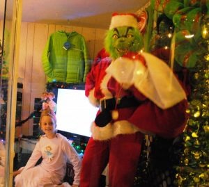 Christmas on the Square: CROWD FAVORITE: Deana Ruth Colwell as the Grinch and Lola Colwell as Cindy Lou Who as LIVE models in the store window of Cantrell's the Home of Fluty