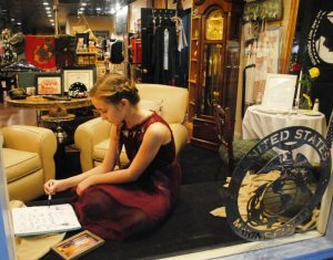 """Christmas on the Square: MOST ORIGINAL: Lily McDerman is a LIVE model in the store window of the Button Willow General Store. The theme is """"Home for the Holidays"""""""