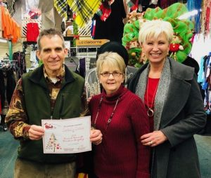 """Window Display: """"Crowd Favorite""""- Cantrell's Clothing's The Grinch. Owners Phillip and Marilyn Cantrell with Chamber Director Suzanne Williams"""