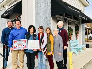 Chamber Presents Community Improvement Award to Headlines Salon : Pictured: Smithville Mayor Josh Miller; Jimmy Poss; Owner J.J. Poss; Stylist Dana West; Chamber Vice-President Beth Adcock; Kathy Hendrixson, Chamber Director Suzanne Williams.