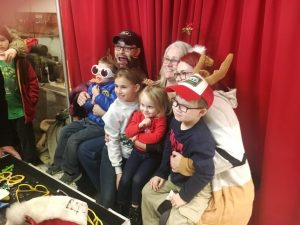 Christmas on the Square 2018: grownups and kids enjoy having photos made of themselves with special props and poses by Cosmo Creations photo booth
