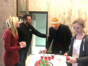 Smithville Mayor Josh Miller greets Mike Braswell during Christmas on the Square in 2018. Mayor Miller and wife Melissa and city employees served refreshments at city hall