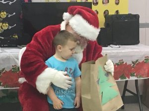 Santa delivers bags of gifts to children at Smithville Head Start Center