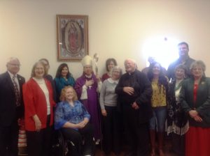 Bishop Mark Spalding visits with parishioners at St. Gregory's Catholic Church