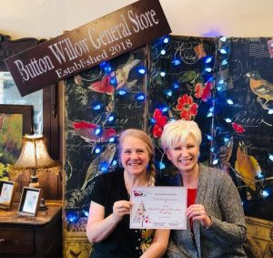 """Window Display: """"Most Original"""": Button Willow General Store's Home for the Holidays. Owner Angela Brown with Chamber Director Suzanne Williams"""