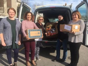 Director of Schools Patrick Cripps with Central Office Staff Amy Lattimore, Elise Driver, Melissa Pirtle, and Martha Taylor loading van with food boxes to be delivered to families served by the Coordinated School Health's Backpack Program