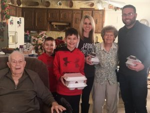 Smithville Mayor Josh Miller and his family deliver Christmas Eve Meals on behalf of the DESA to Gene and Dean Cook on Cill Street. Pictured: Gene Cook, Ethan, Kaden, Melissa, Dean Cook, and Josh