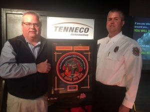 "Blake Cantrell, Communications Officer and firefighter with the Cookeville Highway Station, was selected to receive the Tenneco 2018 ""Git R Done"" Award presented by Lieutenant Andy Pack (right)."
