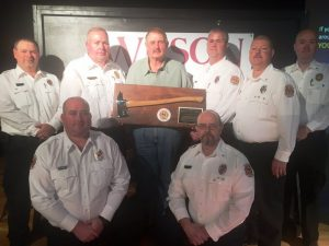 Hugh Washer, firefighter with the Cookeville Highway Station received a special honorary fire axe plaque recognizing his 41 years of exceptional and dedicated service presented by the DeKalb Fire Department's officers: SEATED Captains Brian Williams and Michael Lawrence. STANDING: Lieutenant Dusty Johnson, Chief Donny Green, Hugh Washer, Lieutenant Andy Pack, Captain Jay Cantrell, and Assistant Chief Anthony Boyd