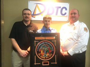 The DeKalb Telephone Cooperative (DTC) Rookie of the Year Award went to Firefighter Travis Checci of the Liberty Station presented by Captain/Training Officer Brian Williams (right). Also pictured Nick Nokes of DTC Communications (left)