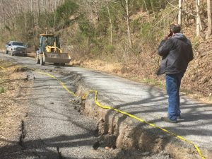 Road Supervisor Danny Hale surveys the scene of the damage to Davis Hollow Road Monday from the recent rains