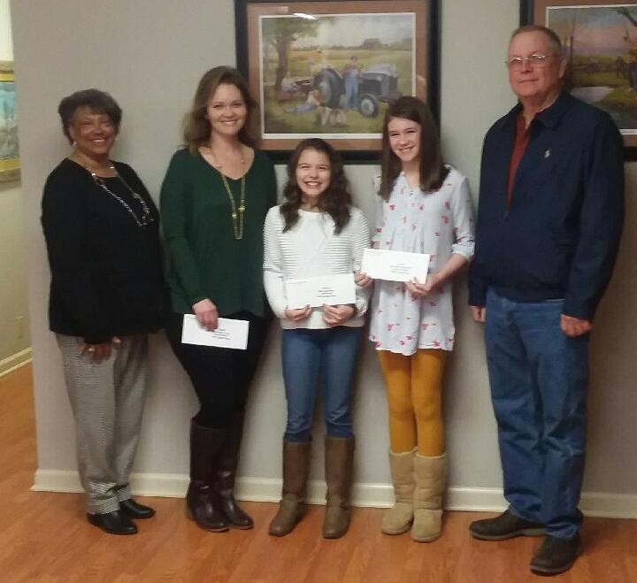 "The Fifth Grade Essay Winners and their teacher were presented awards at the DeKalb Farm Bureau Board Meeting on March 5th. The subject for the essays was ""Why is Agriculture Important?"" Pictured are Cathy Officer, Farm Bureau Women's Chair who presented $50.00 to Kristy Lasser, teacher with the most entries, $50.00 to Cali Agee, First Place Essay, and $25.00 to McKenna Miller, Second Place Essay, and Mack Harney, DeKalb Farm Bureau President. Cali's Essay goes on to State for judging on April 27th."