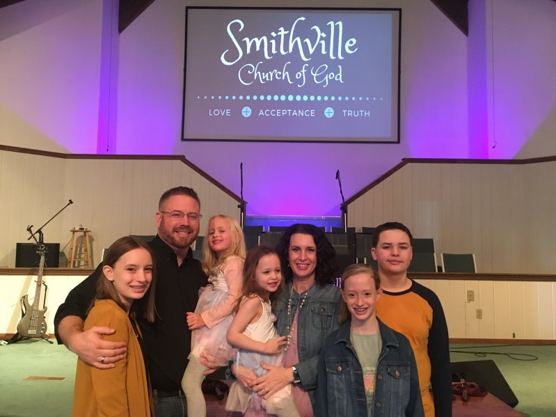 Pastor Chris Moore of the Smithville Church of God, the focus of WJLE's Preacher Feature this week, with his wife Holly and their children: Left to right-Sadie, Chris holding Skyla, Holly holding Saige, Sara, and Samuel.