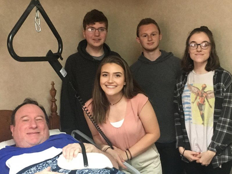 NHC resident Michael Young receives a hand splint made by DCHS students Bailey Hibdon (standing behind her) Ben Felton, Jackub Osment and Channon Stone through the STEM Technology and CTE programs in partnership with NHC Health Care Center of Smithville
