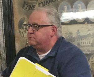 Alexandria's auditor John Poole addresses the mayor and aldermen