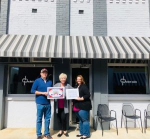 The Smithville-DeKalb County Chamber presented a Community Improvement Award to Anthony and Dana Scott for their beautiful renovations to their downtown Smithville property located at 102 W. Main Street,