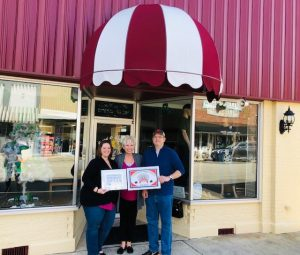 The Smithville-DeKalb County Chamber presented a Community Improvement Award to Anthony and Dana Scott for their beautiful renovations to their downtown Smithville property located at 109 W. Main Street,