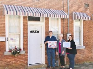 The Smithville-DeKalb County Chamber presented a Community Improvement Award to Anthony and Dana Scott for their beautiful renovations to their downtown Smithville property located at 105 W. Walnut Street.