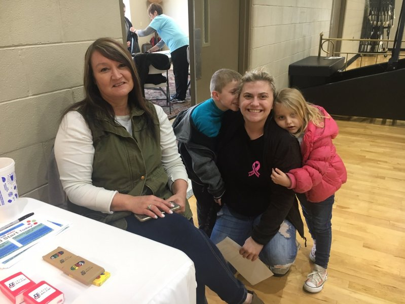 Cathy Shehane, Director of the LBJ & C Smithville Head Start Center (left) with Jase Atnip, Trista Atnip, and Anniston Davidson at the Smithville First Baptist Church Community Day on Saturday