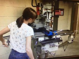 DCHS CTE Machining Technology Course (Student working to make metal objects on milling machine.