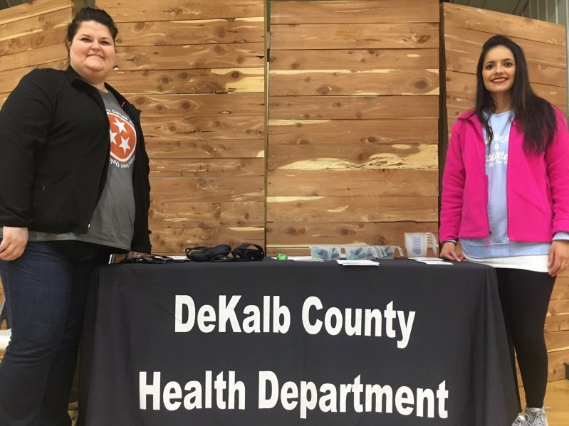 Ashby Woodward (left) and Jessica Terrell of the DeKalb County Health Department at the Smithville First Baptist Church Community Day on Saturday