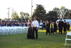 Junior Ushers Emme Colwell and Isaac Cross lead the DCHS Class of 2019 onto the football field for Graduation Friday Night