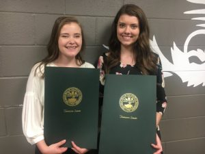 DCHS Class of 2019 Salutatorian Megan Redmon and Valedictorian Madison Cantrell proudly hold resolutions paying tribute to them as adopted in the State House of Representatives and State Senate and signed by the Governor. The presentations were made Friday by State Senator Mark Pody and State Representatives Terri Lynn Weaver and Clark Boyd.