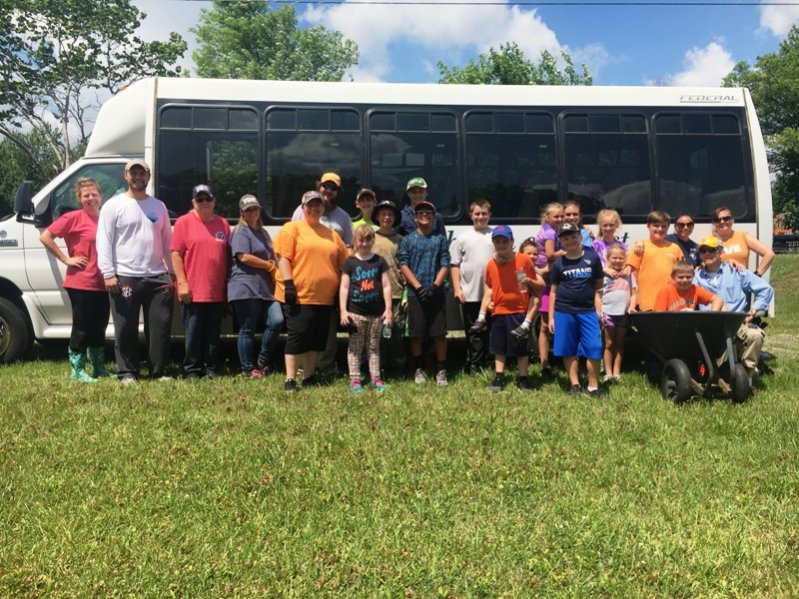 Members of the Smithville Church of Christ are rolling up their sleeves and pitching in to help show their Christian love for others during the congregation's annual Work Camp being held through Thursday this week. Pictured here is one group who spent part of their day Monday working at a residence on Highway 56 south.