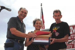 State Senator Mark Pody presented a Tennessee State Flag to Bob and Denise Watke of Spokane, Washington