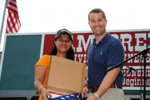 State Representative Clark Boyd gave a United States flag to Maylin Phillips of the Phillipines.