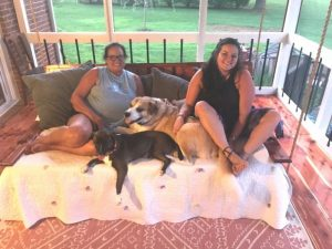 Gayla Hendrix and her daughter Abi, a veterinarian tech at DeKalb Animal Clinic, with their adopted pets, Pal and Sketti, who are very excited about the new dog park.
