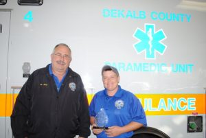 "EMT-Critical Care Paramedic Jamie Vernon is the Upper Cumberland EMS Directors Association's Region IV ""Paramedic of the Year"". The award was presented to Vernon during the association's annual fall symposium October 11 in Cookeville. She is pictured here with DeKalb EMS Director Hoyte Hale"