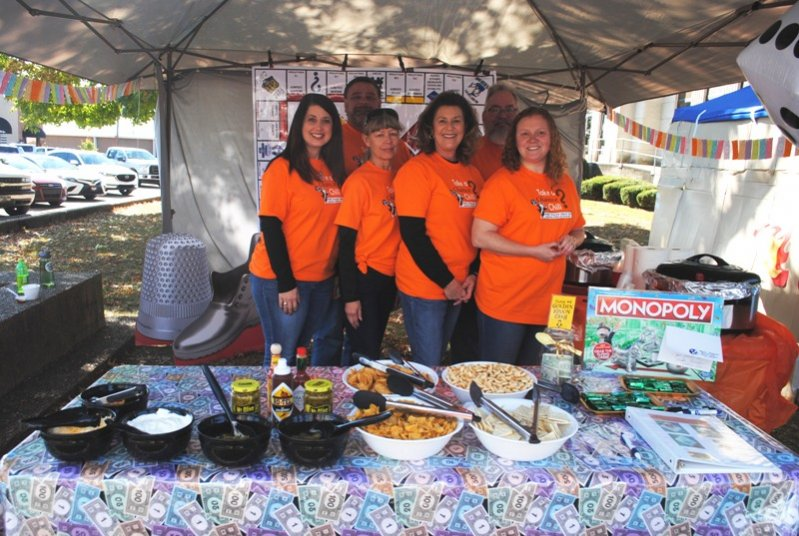"2019 Habitat Chili Cook-Off and Bake Sale: MTNG-Take A Chance Chili?"" from Middle Tennessee Natural Gas wins the Best Decorated Booth Award. Dana London, Greg Vinson, April Gray, Brenda Gay, Cliff Swoape, Rachel Merriman."