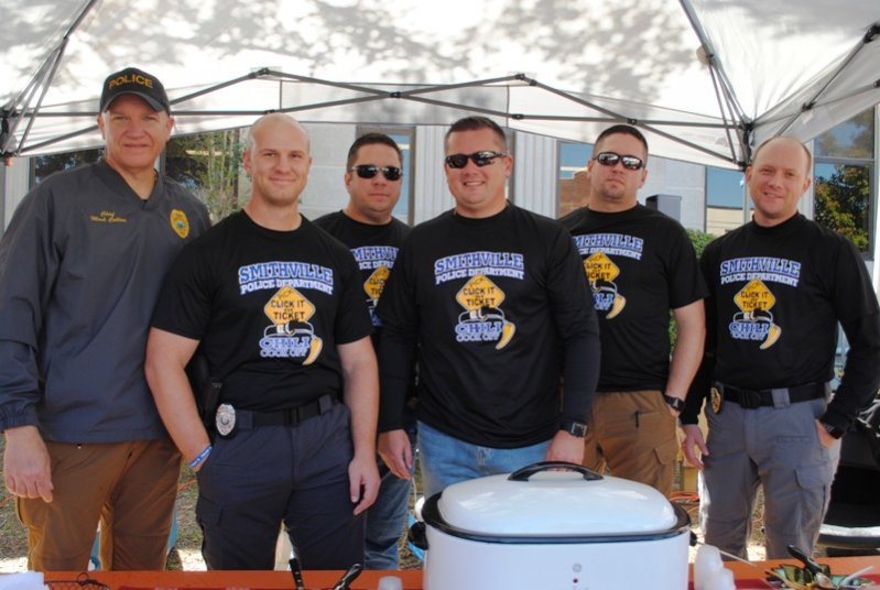 "2019 Habitat Chili Cook-Off and Bake Sale: ""Pick It or Ticket"" from Smithville Police Department took Top Chili Honors. Chief Mark Collins, Officer Will Judkins, Chaplain Dwayne Cornelius, Officer Brandon Donnell, Detective James Cornelius, and Sergeant Lance Dillard."