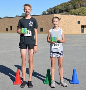 Aaron Gottlied and Madeline Martin are the Overall Male and Female race winners for the 5th Annual 3.21 5K Race for Down Syndrome Awareness. Over 100 participants, ranging in age from 9 years to 70+ years, ran or walked the course at DeKalb West School on Saturday, Oct. 5, 2019.