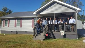 Jamie Nokes Greco and her family celebrated the completion of their home on Sunday afternoon, built in partnership with Habitat for Humanity of DeKalb County. The home is located at 202 Hayes Street in Smithville.
