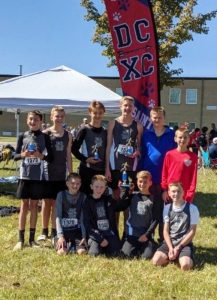 DMS Saints Cross Country team competed at their Mid-State Regional Qualifier meet at Macon County High School on Saturday, October 12th