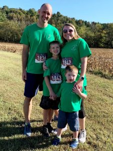 Beckett West, age 5, was the Face of the Race for the 5th Annual 3.21Run4DS race last Saturday in Liberty. Pictured with his parents Andy and Courtney West and his 9 year old brother Keaton