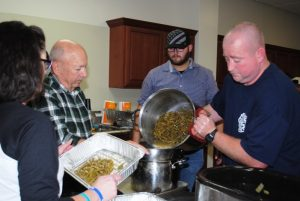 local emergency service providers prepared green beans and other delicious food on Thanksgiving for delivery to the needy in the community