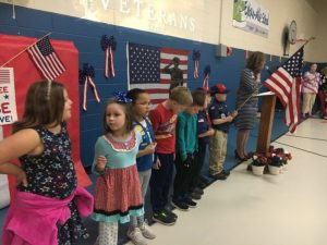 Boy and Girl Scouts present the flag