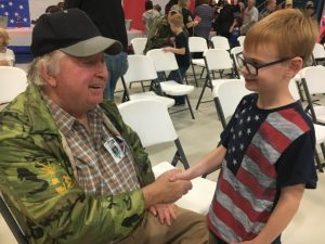 First grader Jackson Longmire shakes hands with Vietnam Era Veteran James Owen after Friday's Tribute Program at Smithville Elementary School. Owen served in the US Army from 1968-70