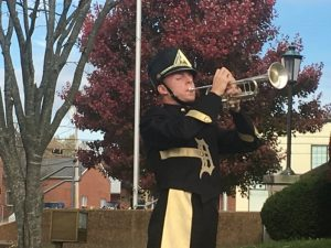 Josh Moon blew taps to bring the Veteran's Day observance to a close.