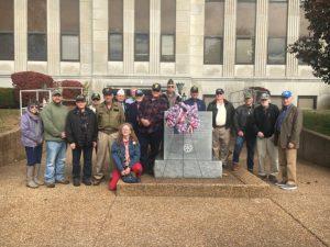 Veterans place wreath at memorial monument following tribute program