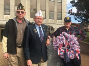 John Davis, Middle Tennessee Vice Commander of the American Legion (center) was the guest speaker at Monday's Veterans Day observance hosted by the American Legion Post 122. Pictured with Legion Commander William Edmonds (left) and Adjutant Ronnie Redmon and a wreath placed at the Courthouse Veterans Monument.