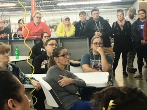 Employees of 620 Pelham, Inc.(formerly known as Omega Apparel) take a break from work Thursday for a meeting to hear from plant manager Amanda Callis and consultant Dick Chase on plans for the new industry.