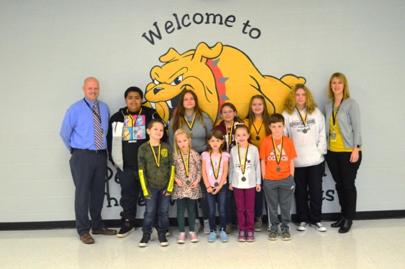 DeKalb West School Students of the Month: Pictured front row left to right: Christian Cripps. Maggie Hendrix, Jordyn Cantrell, Harmony Edwards, and Maddux Pyburn. Pictured back row left to right: Assistant Principal Joey Agee, Jadyn Howard, Teagan Wyatt, Kawasi Troyer, Izzy Prichard, Serenity Patterson, and Principal Sabrina Farler.