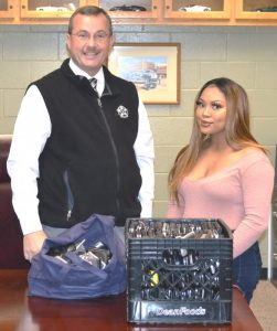 Sheriff Patrick Ray presents 290 donated cell phones to Keesha Williams of the Genesis House for use by victims of domestic and sexual violence