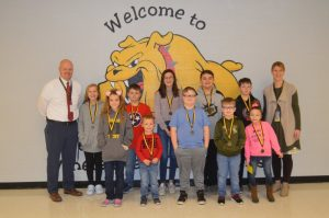 DeKalb West School Announces January Students of the Month: Pictured front row left to right: Zoey Skeen, Gavin Tyree, Logan Winfree, Holden Leiser, and Shaniya Bates. Back row left to right: Assistant Principal Joey Agee, Caroline Crook, Bryce Harvey, Angelina Davenport, Chase Young, Will Bouldon, and Principal Sabrina Farler