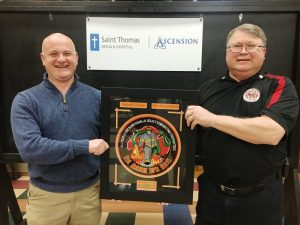 Brad Mullinax (left) presents Steve Repasy, Station Commander of the Midway Station, the 2019 Ascension Saint Thomas DeKalb Hospital Firefighter of the Year Award. Repasy also won the award in 2018.
